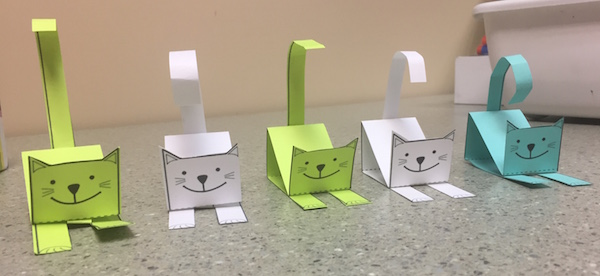 Use figures like these paper cats for Spanish preschool activities.