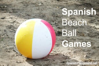 Spanish games for kids with a beach ball.