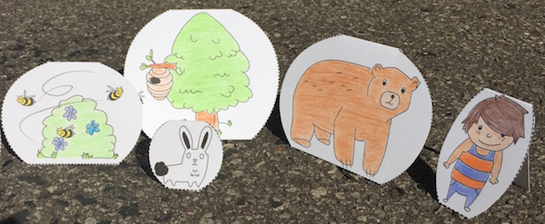 Printable figures to retell a Spanish story about a bear and bees.