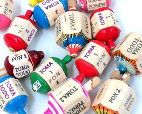 Children learn simple Spanish phrases with this traditional game.