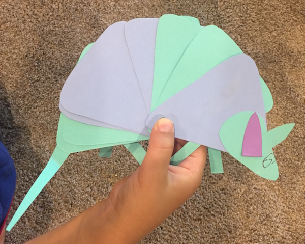 Use moveable paper crafts of animals and people to teach kids Spanish.