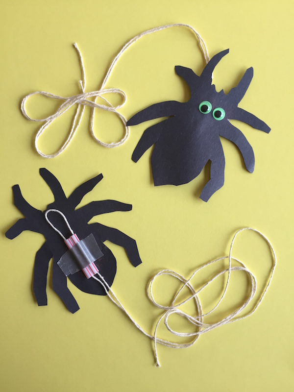 Kids learn Spanish verbs with moveable paper crafts of animals.